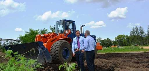 Islip Town Supervisor Tom Croci, left, surveys preparations