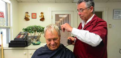 Richard Pastore cuts Richard Baer's hair on July