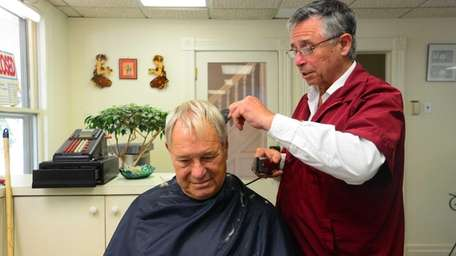 Richard Pastore cuts Richard Baer's hair on July