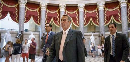 House Speaker John Boehner of Ohio strides to