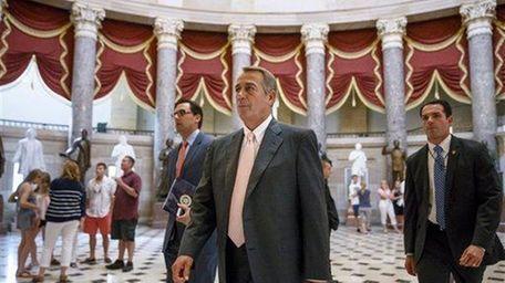 House Speaker John Boehner of Ohio strides to