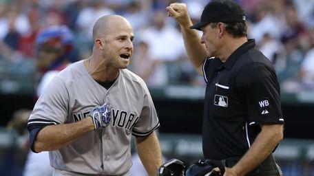 The Yankees' Brett Gardner, left, yells at home