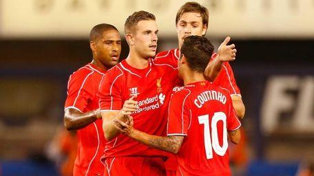 Jordan Henderson of Liverpool celebrates scoring a goal