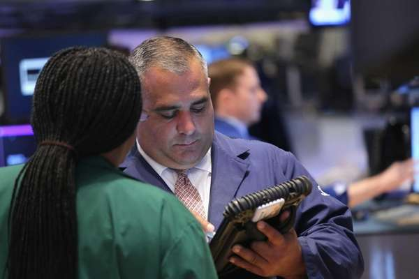 Traders work the floor of the New York