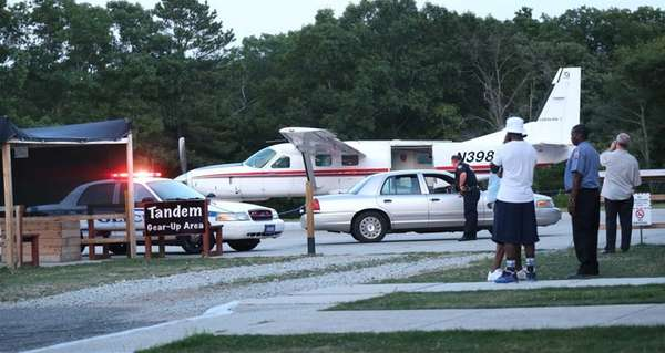 A skydiving plane is towed back to its