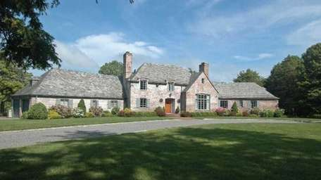 This French provincial home sits on Lower Winganhauppauge