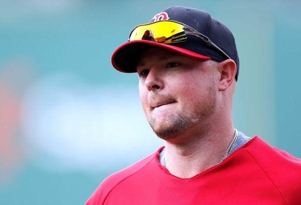 Jon Lester of the Boston Red Sox leaves