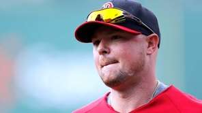 Jon Lester of the Boston Red Sox leaves