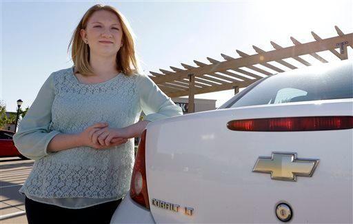 Wendi Kunkel stands with her 2010 Chevy Cobalt