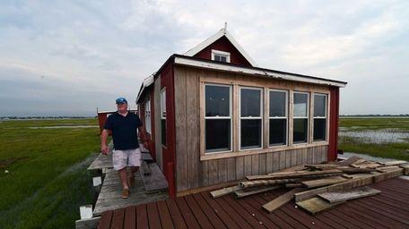 Ryan Stenzel walks along the deck around his