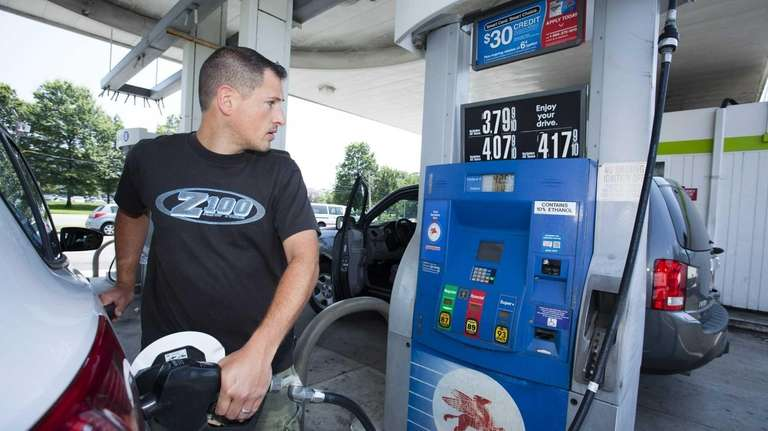 Scott Boudini, 38, of Old Bethpage, fills up