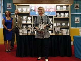 "Hillary Clinton holds her new book, ""Hard Choices,"""