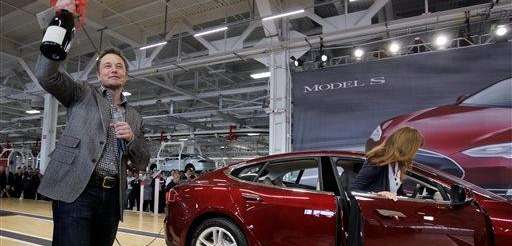 Tesla Motors Inc. CEO Elon Musk holds up