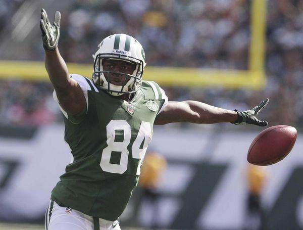 Jets wide receiver Stephen Hill celebrates after making