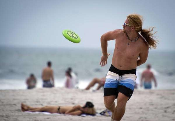 Long Beach resident Stephen Fregosi catches a frisbee