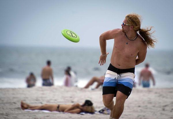 Long Beach resident Stephen Fregosi catches a frisbee