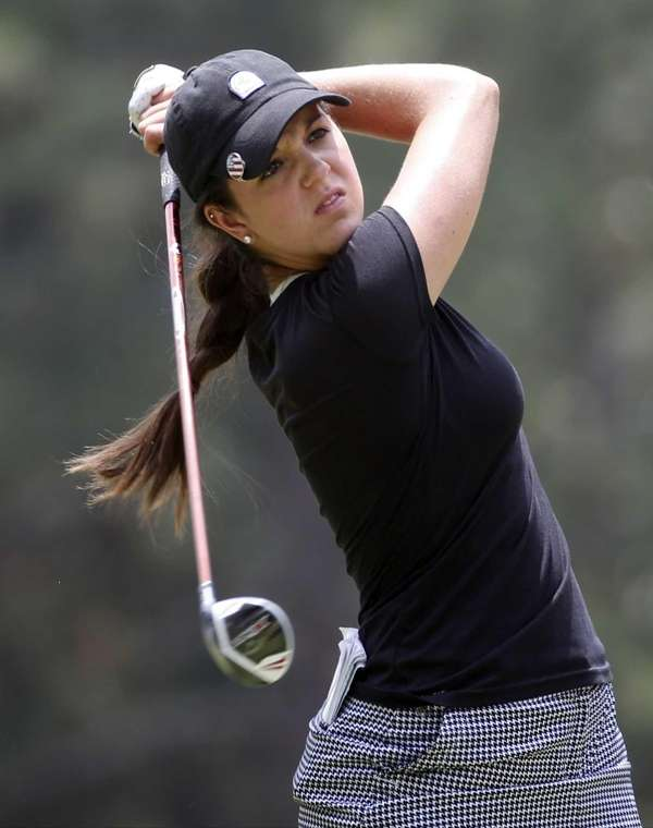 Emma Talley watches her tee shot on the