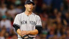 Chris Capuano #26 of the Yankees reacts after