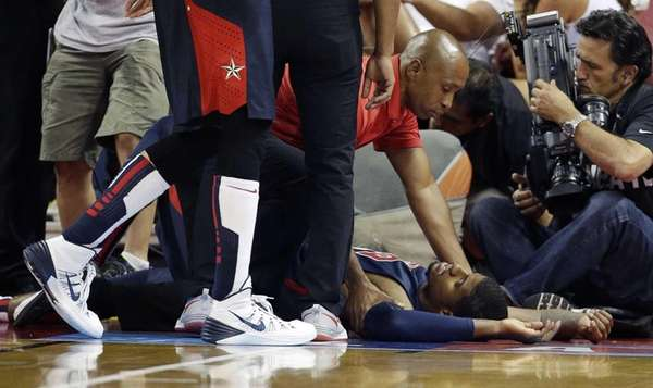 Indiana Pacers' Paul George lies on the court