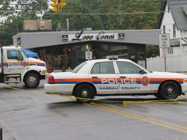 Nassau police block off the scene of a