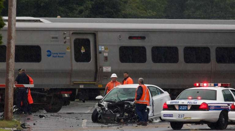mta driver injured when lirr train hits vehicle on tracks in huntington station newsday. Black Bedroom Furniture Sets. Home Design Ideas