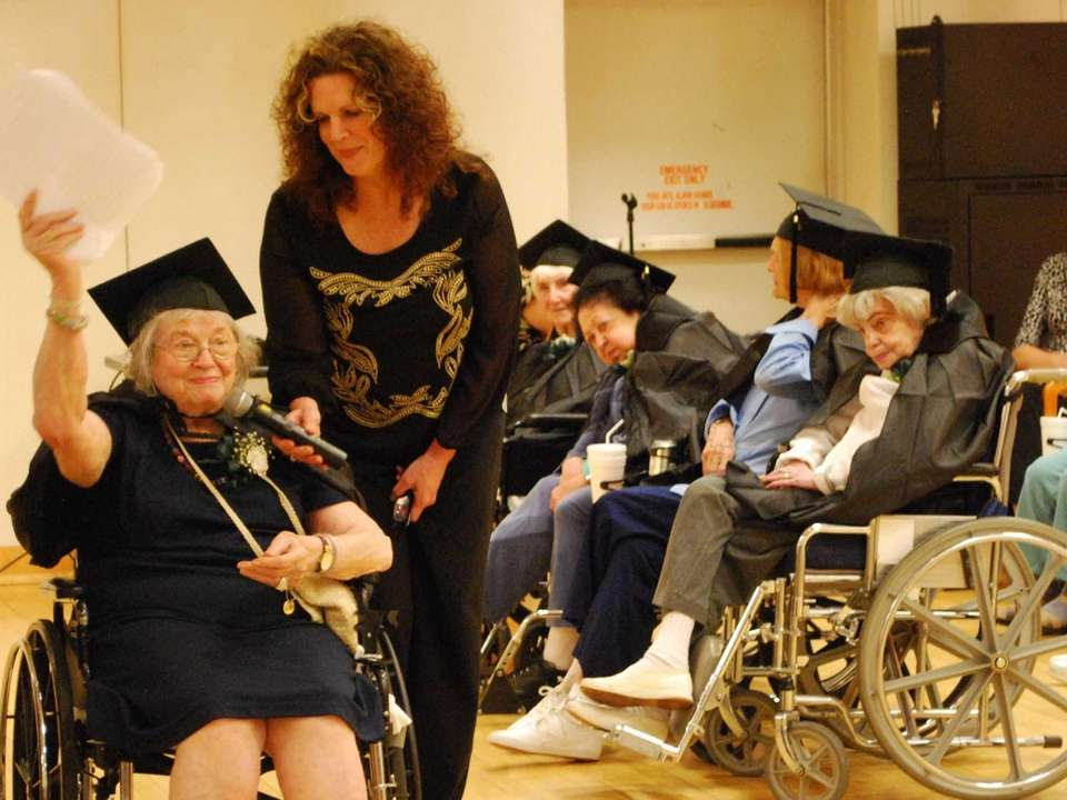 Valedictorian Berthe Gersten, 93, of Commack, congratulates fellow