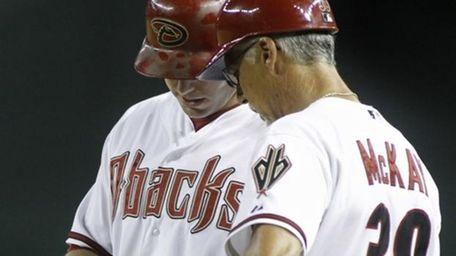 Arizona Diamondbacks' Paul Goldschmidt, left, shows first base