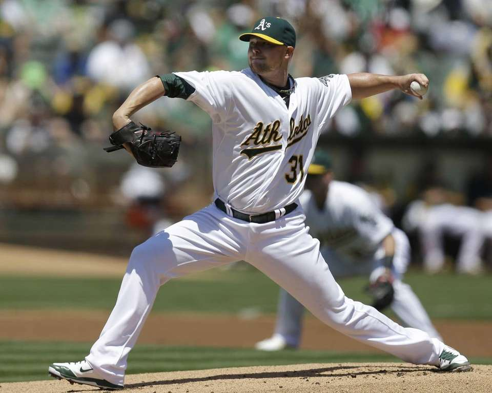 Oakland Athletics' Jon Lester works against the Kansas
