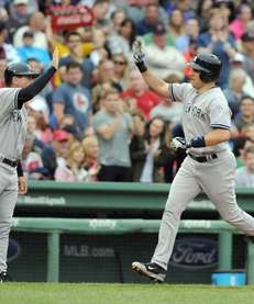 Mark Teixeira of the Yankees rounds the bases