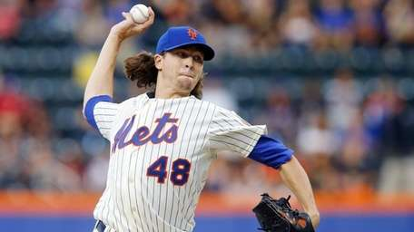 Jacob deGrom of the Mets pitches against the