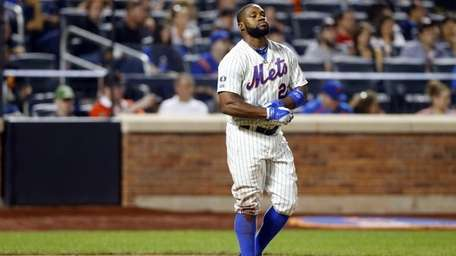 Eric Young Jr. of the Mets strikes out