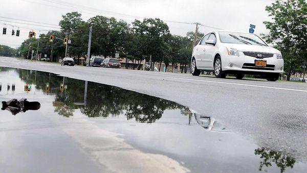 A puddle along Horseblock Road near Route 112