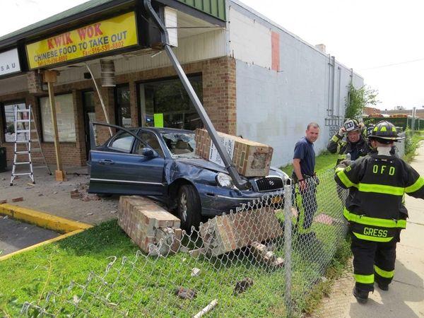 A sedan jumped a curb at an Oceanside