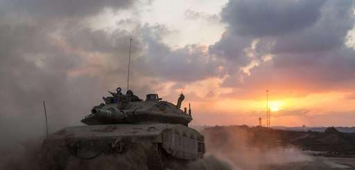 An Israeli Merkava tank rolls back from the