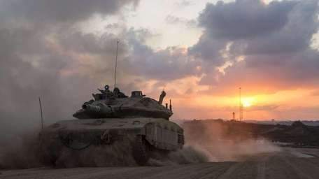 An Israeli Merkava tank rolls back from the