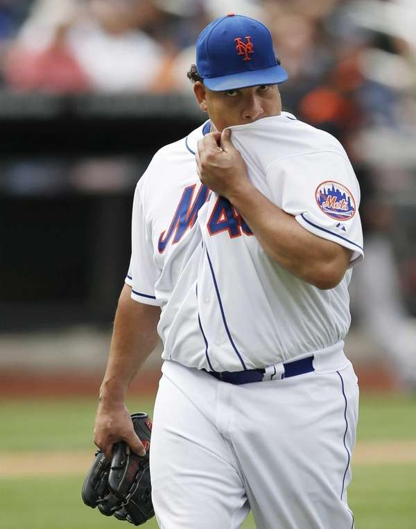 Mets starting pitcher Bartolo Colon reacts after Mets