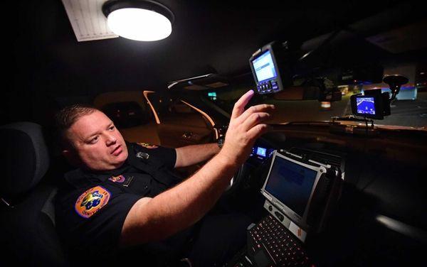 Nassau County Patrolman Sam Ferrandino demonstrates the new