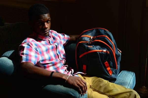 17 year-old Bakary Diallo with a backpack donated