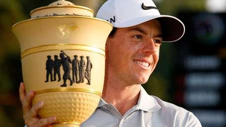 Rory McIlroy of Northern Ireland holds the Gary