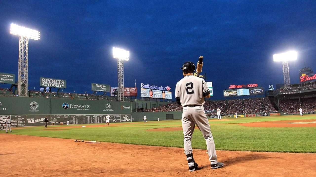 Derek Jeter prepares to bat in the first