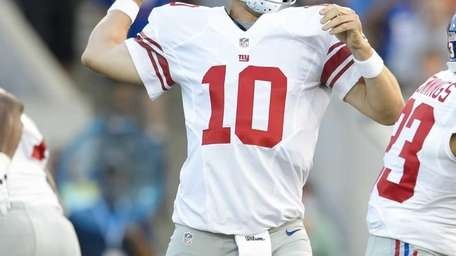 Giants quarterback Eli Manning throws a pass during