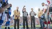 Jim Kelly watches the official coin toss before