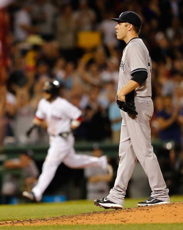 Yankees pitcher David Phelps looks toward home as