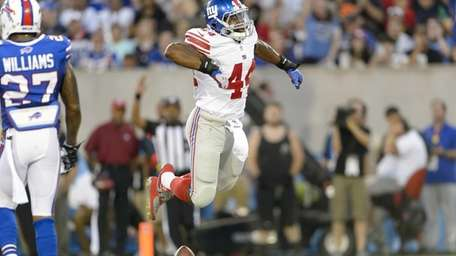 Giants running back Andre Williams celebrates after running