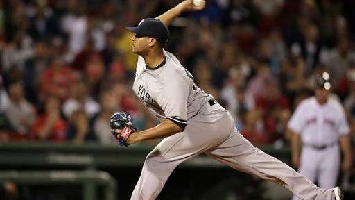 The Yankees' Esmil Rogers delivers a pitch against