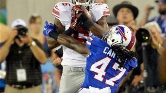 Giants wide receiver Corey Washington, left, catches a