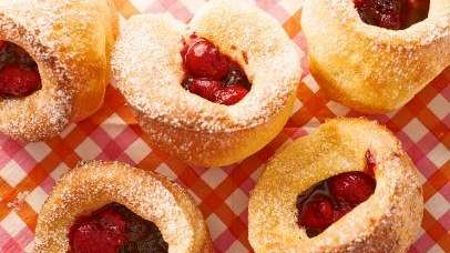 The popovers with mixed berry sauce can be