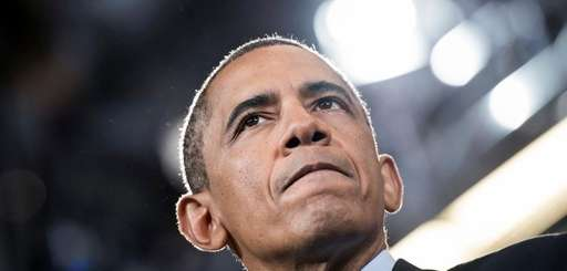 President Barack Obama pauses while speaking at Knox