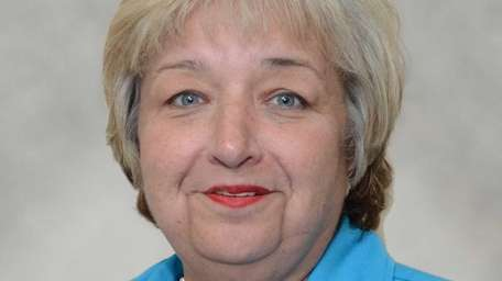 Patricia Wiederman of East Marion has been promoted