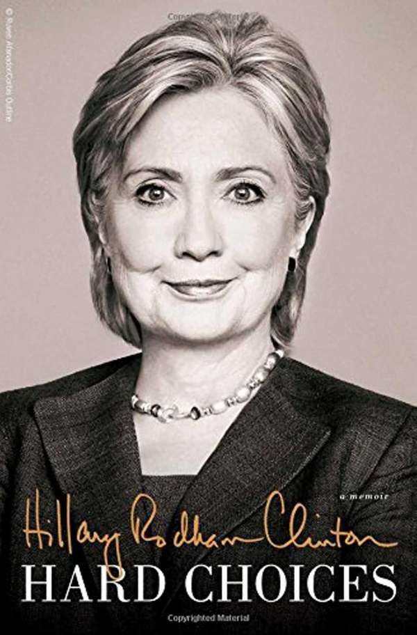 Hillary Clinton signs her new memoir,